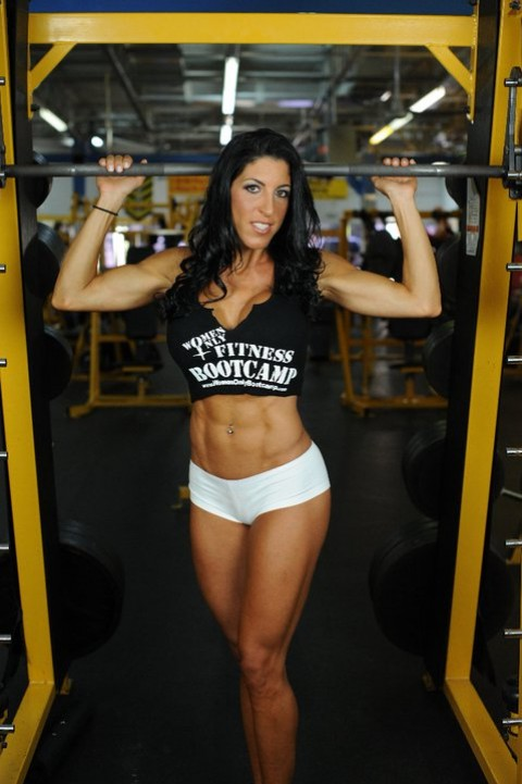 Lorraine posing at the gym